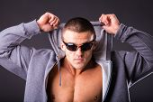 picture of fitness man body  - Guy in a sports jacket and sunglasses - JPG