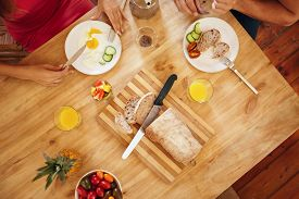 stock photo of breakfast  - Top view of couple eating a healthy morning breakfast at home - JPG