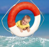 smiling boy in ring-buoy