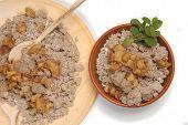 Buckwheat Ravioli On A Wooden Plate (Traditional)