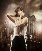 picture of fine art portrait  - Fine art photo of a beautiful woman in front of a building - JPG