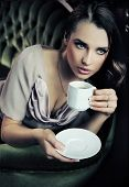 Young beautiful lady drinking coffee