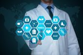 Medical doctor working with healthcare icons. Modern medical technologies concept poster