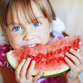 pic of healthy eating girl  - Funny child eating watermelon closeup - JPG