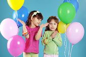 stock photo of birthday party  - Happy children with colorful air balloons over blue - JPG