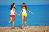 Beautiful girls having fun at beach