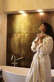 a woman with a bathrobe in bathroom