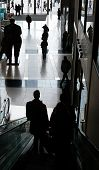 Silhouette Of Customers On Escalator Of Posh Public Mall At Columbus Circle In Manhattan