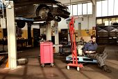stock photo of auto garage  - auto mechanic in his workshop - JPG