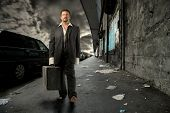 business man walking on city street