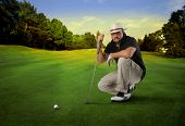 golf player with putter thinking of good shot