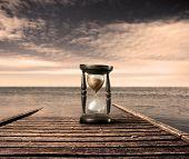 hourglass on a wharf