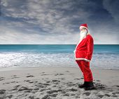 funny santa standing on beach