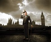 stock photo of big-ben  - Portrait of a man in elegant suit standing in front of the Big Ben in London - JPG