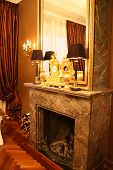 foto of gobelin  - classic baroque fireplace with mirror and baroque design - JPG