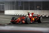 SINGAPORE - SEPTEMBER 26: Ferrari's Felipe Massa races at the 2008 Singtel Singapore F1 Grand Prix o