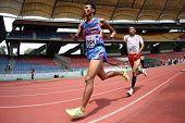 KUALA LUMPUR - AUGUST 15: Thailand's amputee athlete Sangat Chaikhini (L) runs at the track and fiel