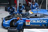 SEPANG, MALAYSIA - JUNE 21: The Calsonic Impul GT-R Nissan car (12) pitting for tyre change at the S