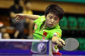 KUALA LUMPUR, MALAYSIA - SEPTEMBER 24: Guo Yue of China stretches to return the ball in her match du