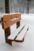 Bench In Winter Park At Snowfall