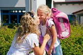 stock photo of say goodbye  - Mother taking her daughter to school - JPG