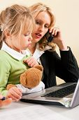 Family Business - telecommuter Businesswoman and mother having trouble  to concentrate on her work w