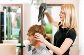 stock photo of she-male  - Man at the hairdresser - JPG