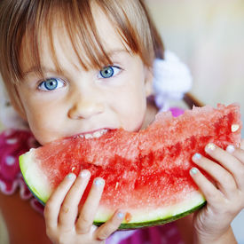 foto of healthy eating girl  - Funny child eating watermelon closeup - JPG