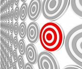 Many bulls-eye targets in rows and one in red representing a niche market in a crowded marketplace o