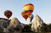 Hot Air Balloons Over Cappodocia Terrain