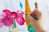 art, creativity and people concept - hand of artist with paint brush painting still life picture poster