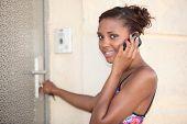 Woman unlocking her frontdoor