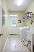 residential laundry room with white appliances