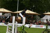 Girl jumping Pony on horseshow