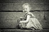 pic of cute little girl  - Cute Little baby find something on the ground  - JPG