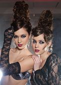 picture of mystique  - Two glamour girls twins in underwear pose in a smoke - JPG