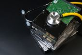 Internal Sata Type Hard Disk Drive And Stethoscope With Copy Space On Black Background For Protect D poster