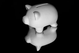 pic of stewardship  - A piggy bank in white on a black background - JPG