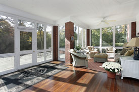stock photo of screen-porch  - Porch in suburban home with access to patio - JPG
