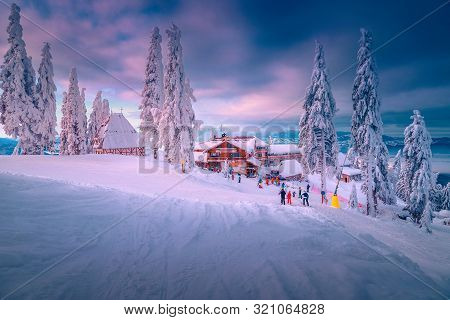 poster of Spectacular Winter Ski Resort With Skiers In Romania. Fantastic Touristic And Winter Sport Holiday L