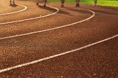 Shadow Of Running People Exercise Or Workout For Health On The Red And Curve White Line Track Floor  poster