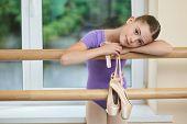 Beautiful Caucasian Child At Ballet Studio. Little Tired Ballerina After Ballet Dance Classes. Studi poster