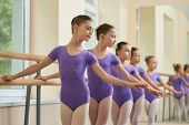 Children In Ballet Dance Class. Group Of Young Ballerinas In Similar Suits Training At A Classical B poster
