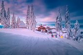 Spectacular Winter Ski Resort With Skiers In Romania. Fantastic Touristic And Winter Sport Holiday L poster