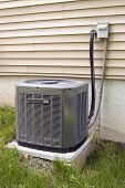 foto of air conditioning  - A residential central air conditioning unit sitting outside a home - JPG
