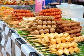 Meatballs on sticks at a market