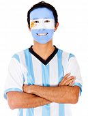 Happy Argentinean man with flag painted on his face - isolated