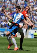 BARCELONA - APRIL 15: Alvaro Vazquez of Espanyol fights with Jeremy Mathieu of Valencia CF during a