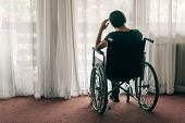 Depressed Sad Woman In Worn Wheelchair Looking Out The Window And Thinking, Lonely Disabled Adult Ca poster