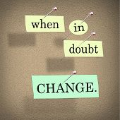 The words When in Doubt Change pinned to a cork bulletin board representing self-help improvement ad